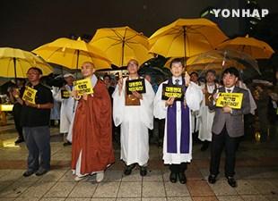 韩国宗教人士举行祈祷会 呼吁制定沉船特别法